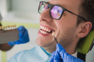 dental implants services, man receiving tooth implants
