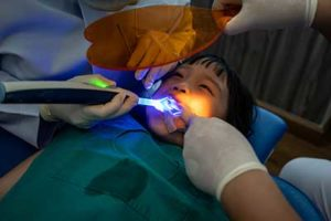 fluoride treatments tx, child in dental chair during procedure