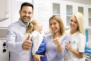 a family poses at their family dentistry